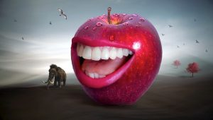 Big red apple with human teeth and smiling open mouth.
